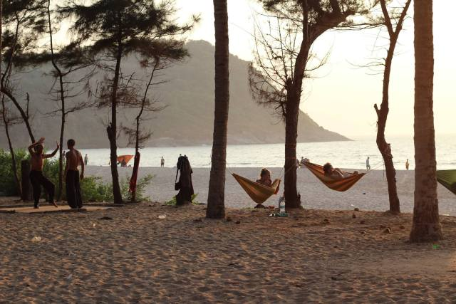 People sit in hammocks enjoying the sunset in Gokarna's Kudle Beach