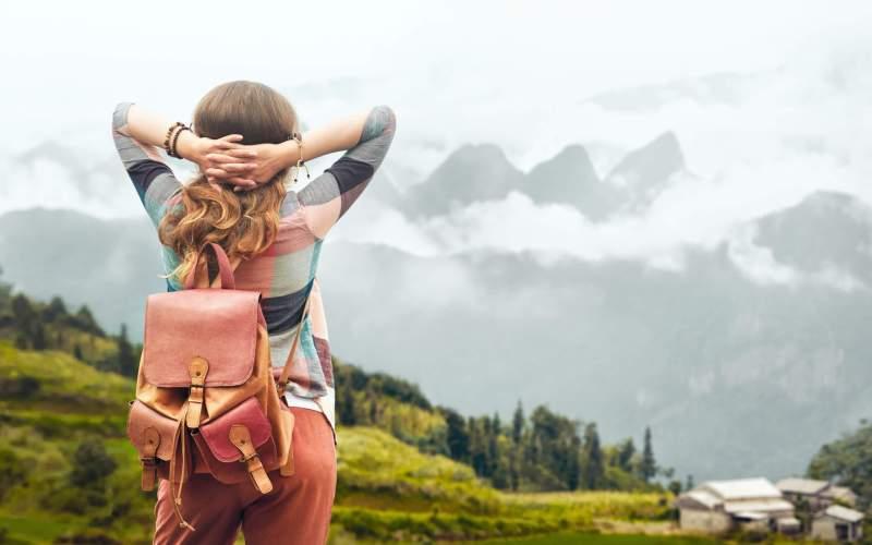 Female traveler following a trip itinerary
