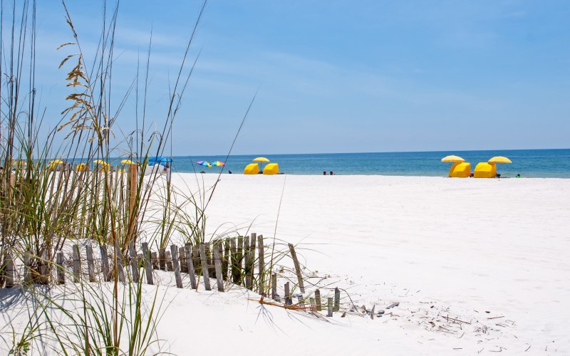 Sitting on a gorgeous white-sand beach is one of the best things to do in Gulf Shores, Alabama