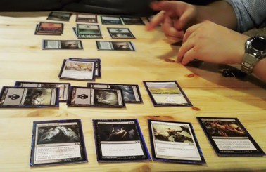 Phillippee teaching how to play Magic the Gathering.