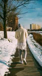 pexels photo 3240533 - man walking on pathway