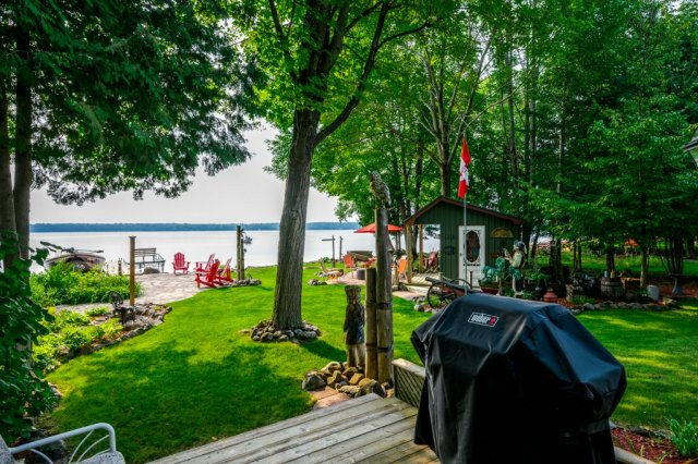 068 26 fire rte 103 bobcaygeon ON deck yard - WATERFRONT ~ 4 SEASON COTTAGE FOR SALE ON PIGEON LAKE