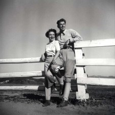 "1950s Ronald Reagan and Nancy Reagan (Close up) posing leaning against a fence at their Malibu Canyon Ranch ""Yearling Row"""