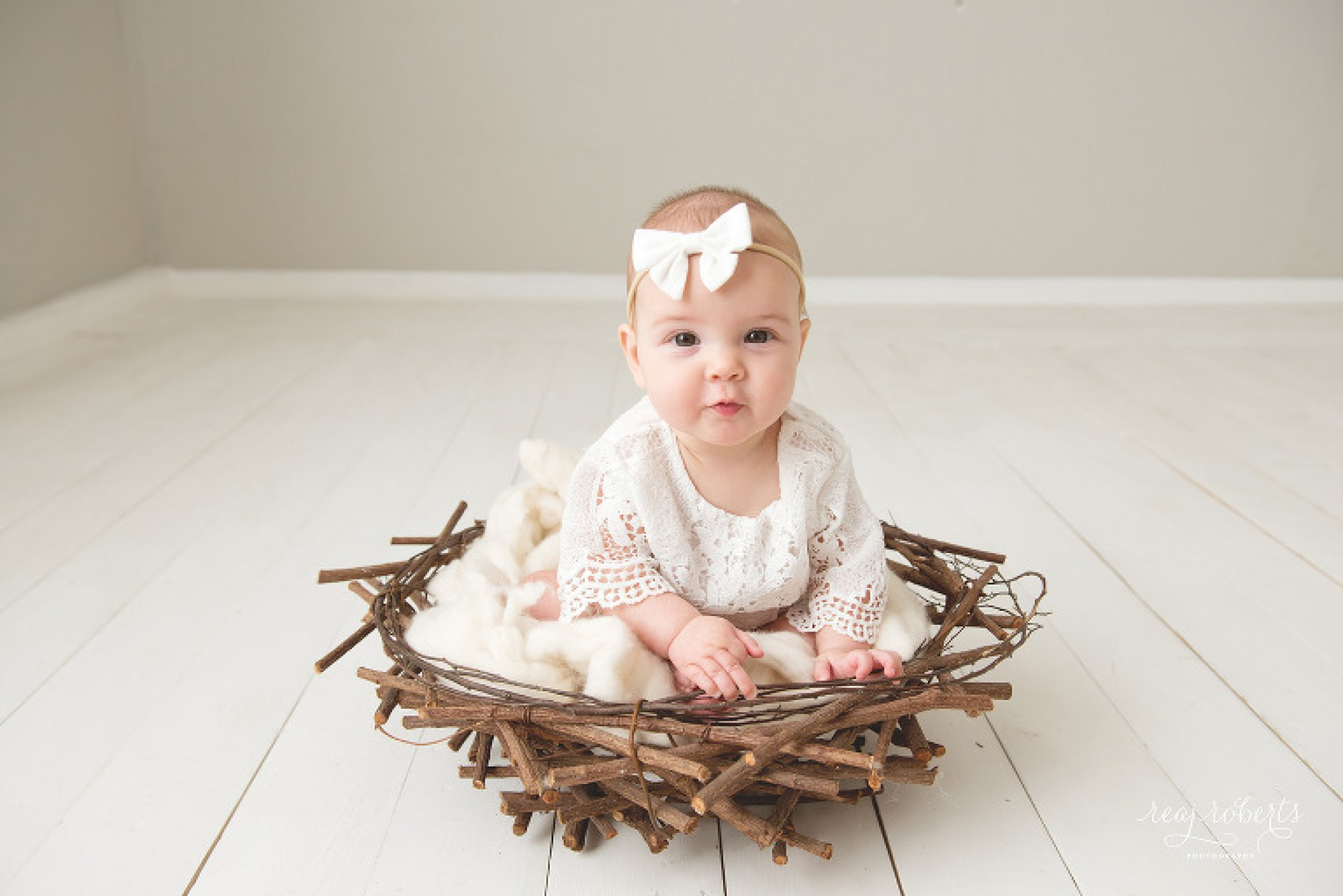 Baby girl in nest photographer | Reaj Roberts Photography