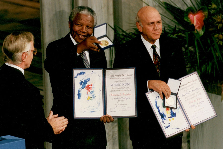 Nelson Mandela and FW de Klerk showing their Nobel Peace Prize in 1993.