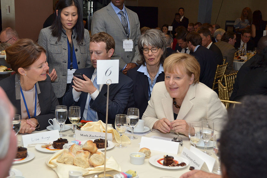 Lise Kingo with Mark Zuckerberg of Facebook and German Chancellor Angela Merkel.