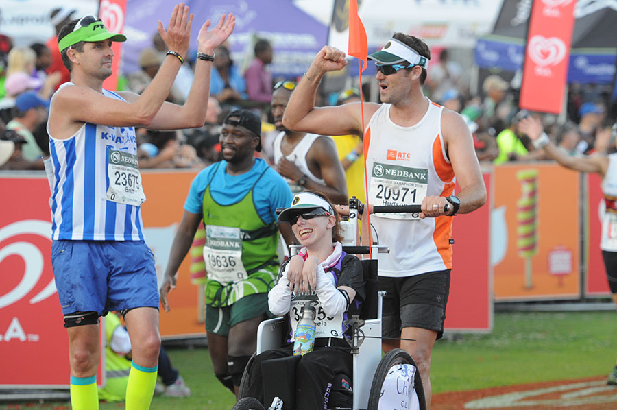 Mycroft at the finish line of the Comrades Marathon in South Africa - the first wheelchair participant in the marathon's 95-year history.