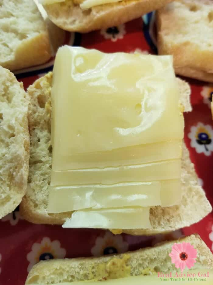 Prepare a delicious snack for your tailgating party like this oh so yummy Hot Ham and Cheese sandwiches recipe