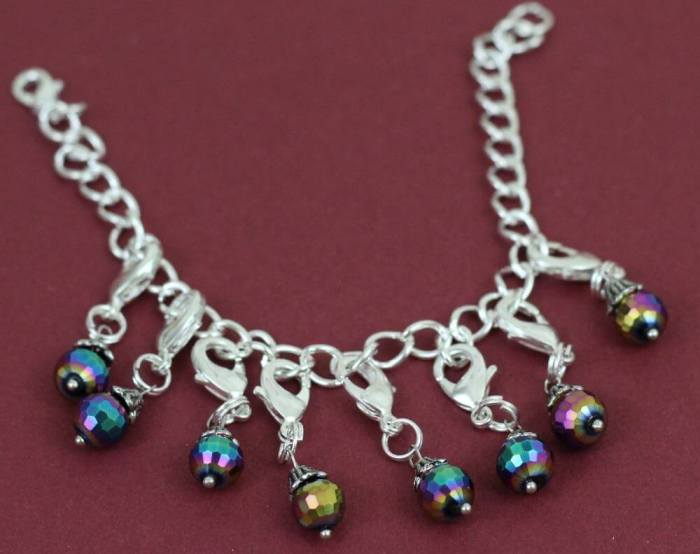 Put all of the charms on one of the bracelets