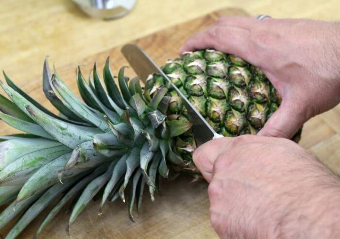 Cut the top off of the pineapple and save it