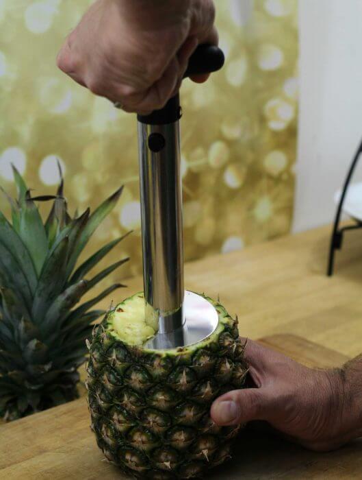 Start turning the pineapple corer