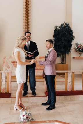 Darcie and Logan exchanging rings at St. Paul's church San Diego