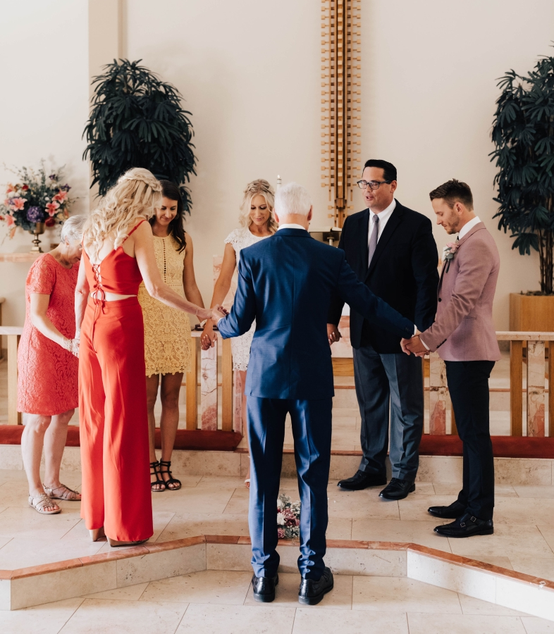 Prayer at wedding of Darcie and Logan St. Paul's church San Diego