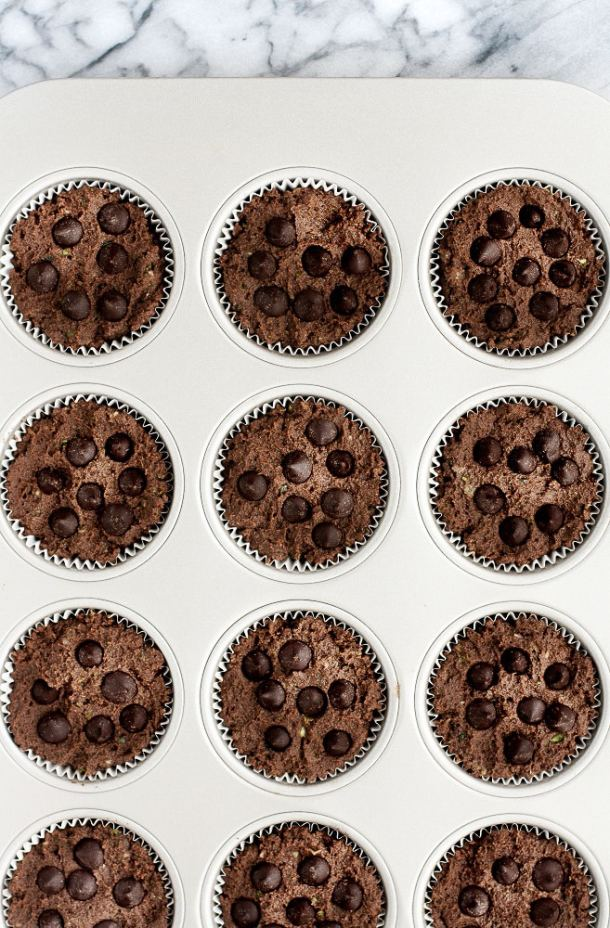 Low-Carb-Triple-Chocolate-Zucchini-Muffins-in-muffin-tin-with-chocolate-chips-before-baking