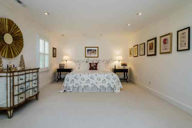 025 Stonehenge Beaut on Riddle Place presented by MORE Real Estate Group_ Master Bedroom