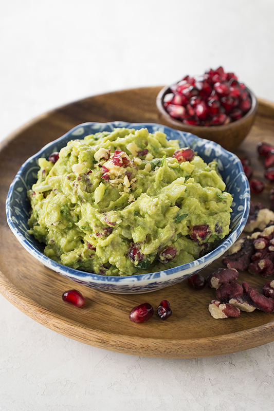 Pomegranate Walnut Guacamole l pomegranate seed arils and red walnut guacamole dip