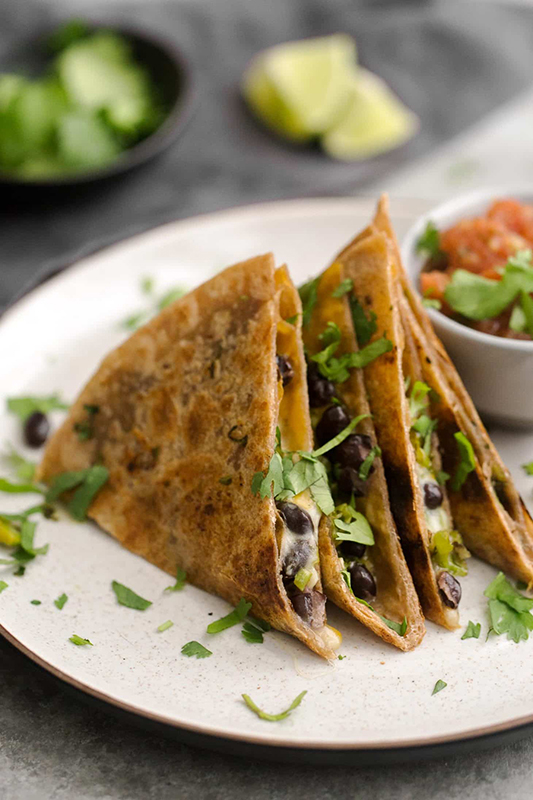 25 delicious ways to spice up National Pepper Month l black bean quesadillas with shishito peppers