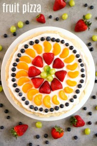This gluten free fruit pizza is a healthy, delicious summer dessert with a great presentation. A sugar cookie crust is topped with coconut cream frosting and assorted fruit.