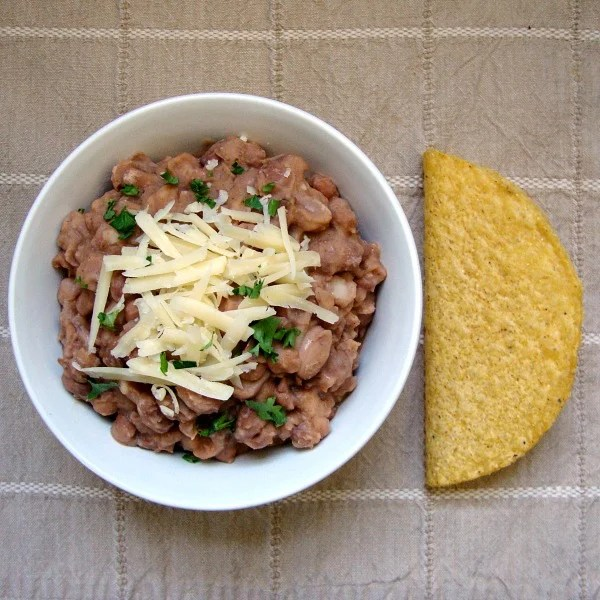 These slow cooker pinto beans are easy to make for taco night. The secret ingredient helps to nullify the gassy side effects.