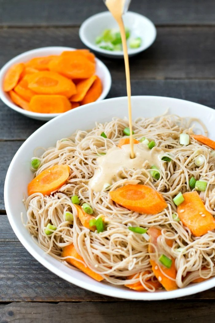These rice noodles with peanut sauce are a healthy, kid-friendly, high-protein side dish. You'll love this easy recipe for a quick dinner.
