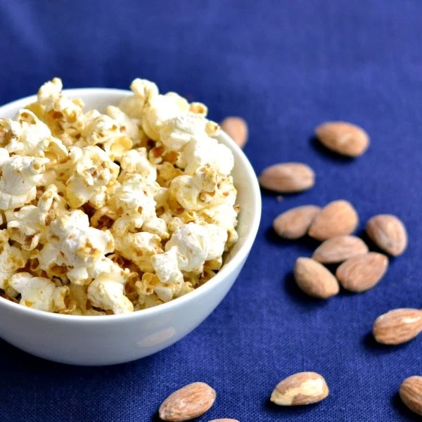 I can't get enough of this healthy vanilla almond popcorn! Great snack recipe for a road trip.