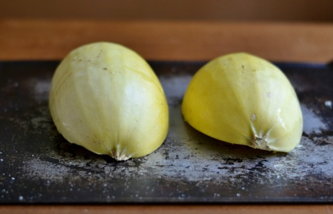 Place the oiled halves of the spaghetti squash face-down on a cookie sheet.