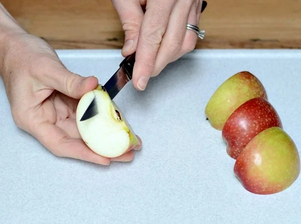 Coring apple with paring knife