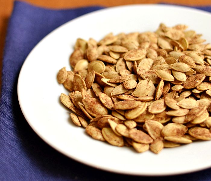 These roasted cinnamon pumpkin seeds are a healthy snack for fall.