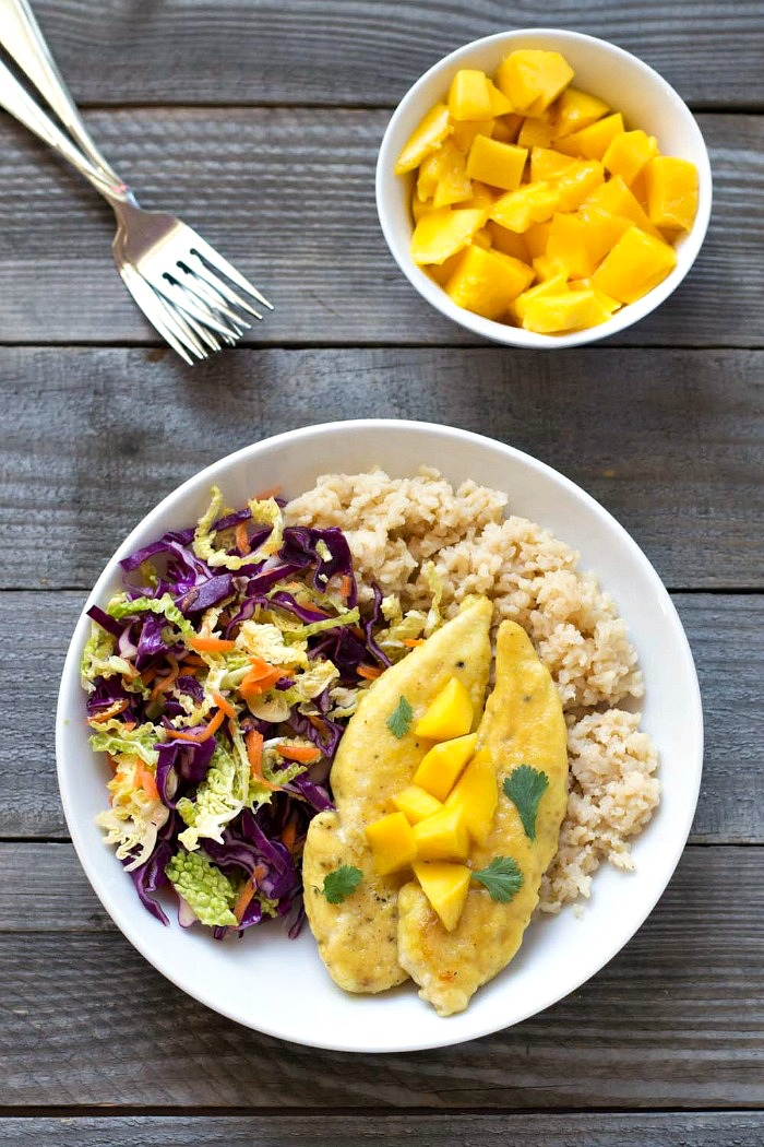 This mango chicken with tropical slaw is a delicious dinner recipe full of sweet, tropical flavors. This healthy meal is always a crowd-pleaser! I can't get enough of it.