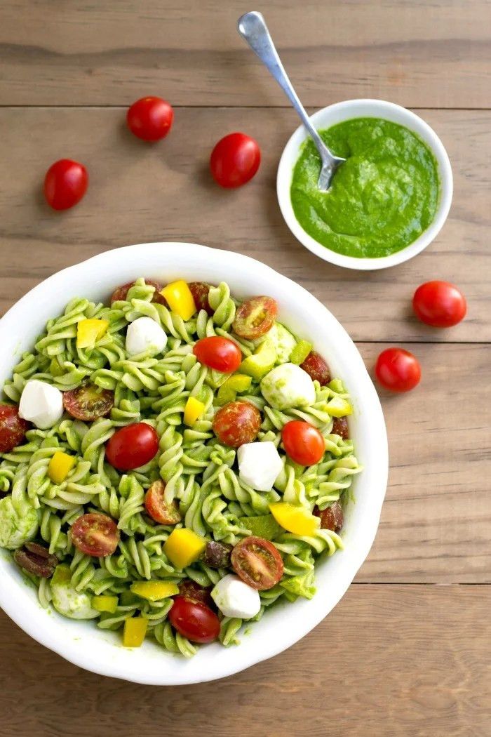This pesto pasta salad is such a flavorful side dish or light summer dinner. It's an easy, healthy recipe full of fresh produce. Your family will love it!