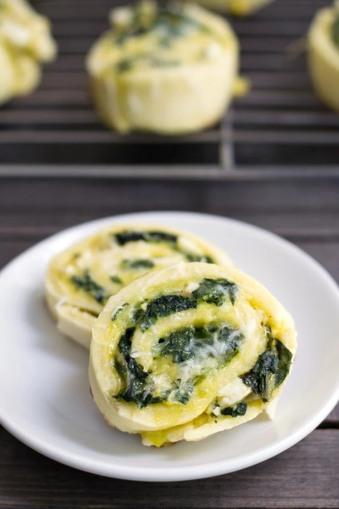 These Spinach Feta Pinwheels are so full of flavor! This healthy appetizer or lunch box recipe is a great way to eat your greens. (Gluten-free)