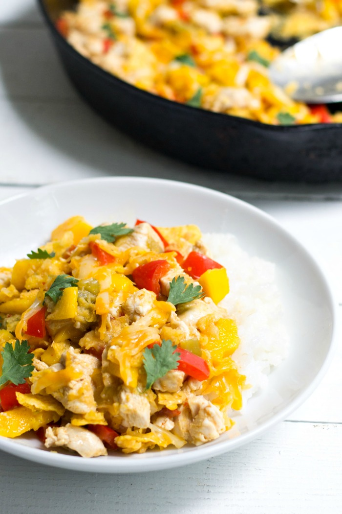 This mango chicken tortilla skillet is an easy, one dish meal that's so full of flavor! Everyone will love this healthy, gluten-free dinner recipe.