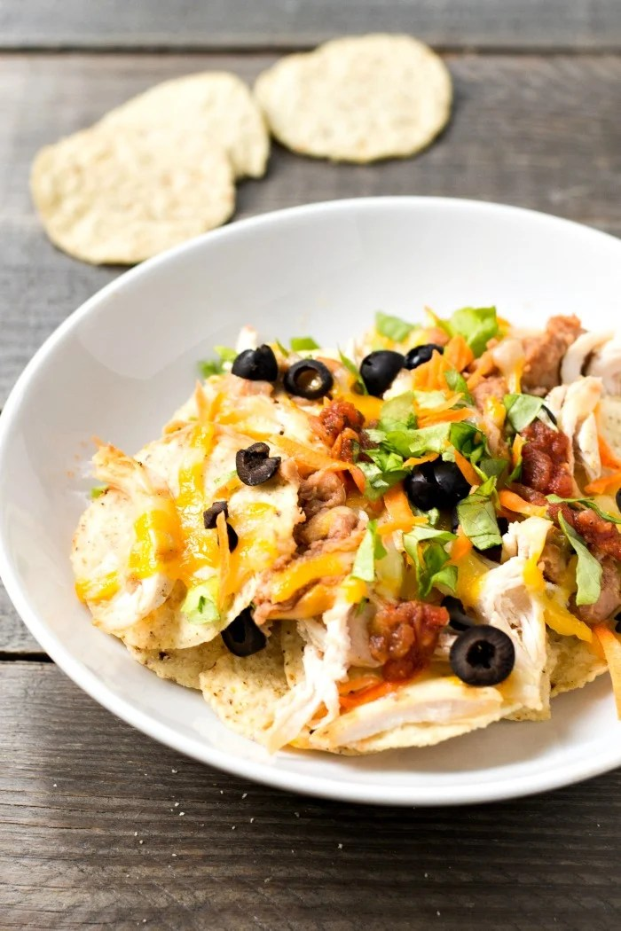 These grilled chicken nachos are the perfect quick dinner! This healthy, casual recipe also makes a great gluten-free appetizer. Recipe from realfoodrealdeals.com