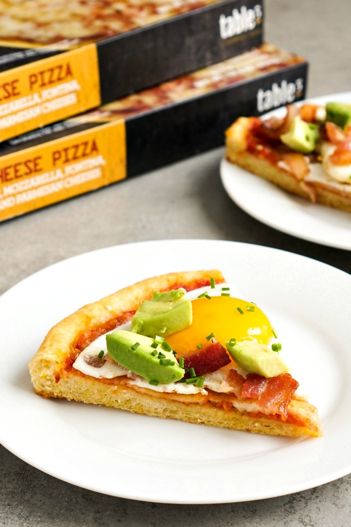 This bacon egg avocado pizza is such a delicious twist on pizza night! It features a delicious cornmeal crust from Table5.