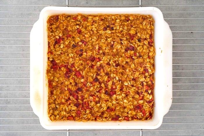 Pumpkin cranberry oat bars cooling in a pan
