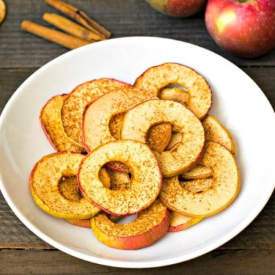 Dehydrated apple chips on plate