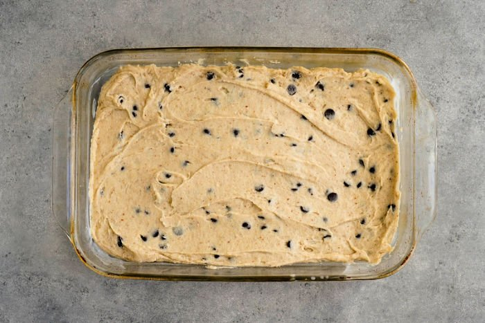 Blondie batter in a glass pan