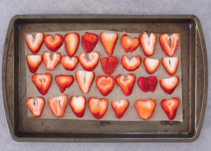 Sliced berries on baking sheet