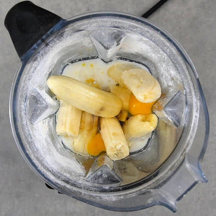 Banana, egg, coconut oil, coconut milk, and syrup in the blender