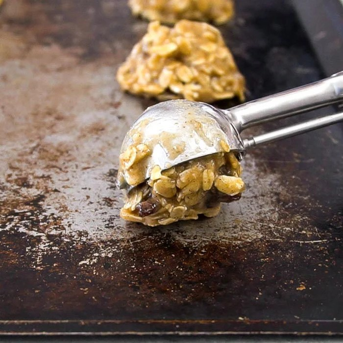 Cookie dough being put on baking sheet