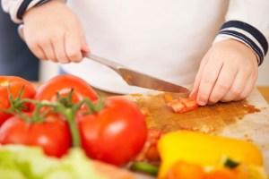 Child making salad