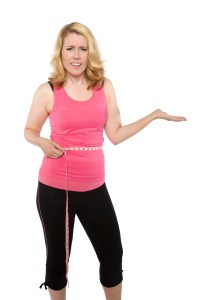 woman-measuring-her-waist-frustrated-200x300 REAL fitness tips for a tight toned midsection