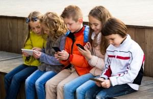 kids-on-iphone-300x195 Kids,Cell Phones,Computers,Internet...setting boundaries.
