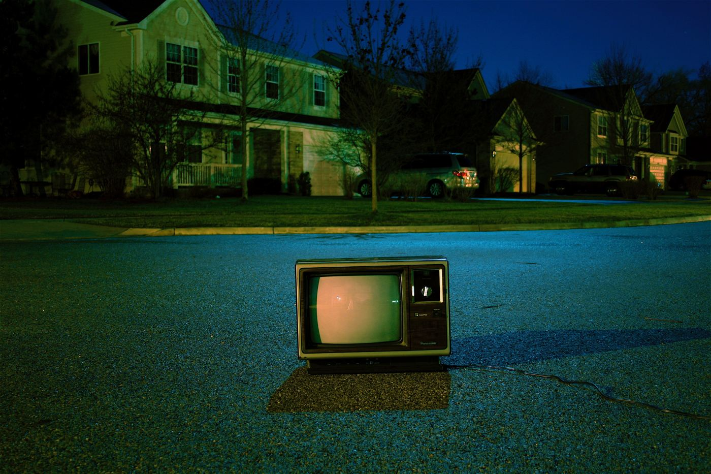turned off vintage CRT television on road at night