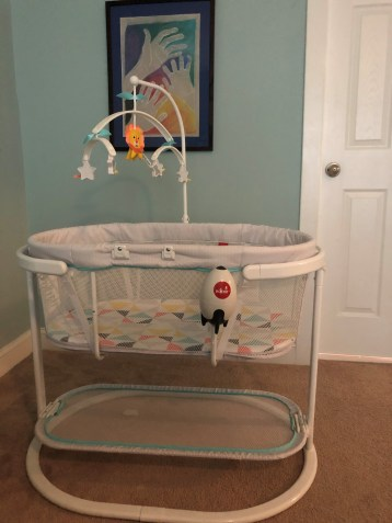 Fisher-Price Soothing Motions Bassinet with Rock-It attached.