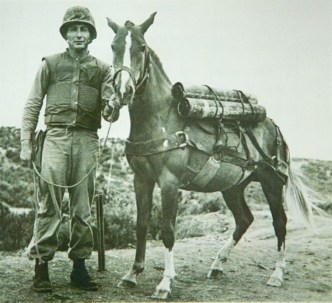 Reckless the horse stands beside her friend and trainer Platoon Sergeant Joe Latham