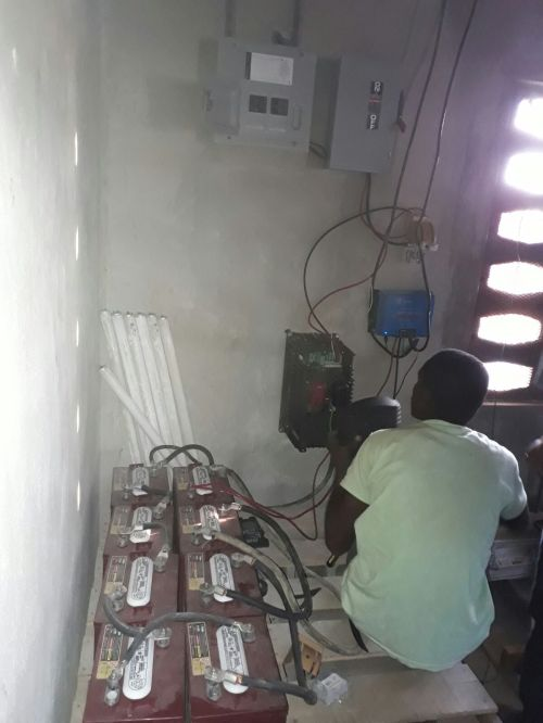 small resolution of solar panels batteries inverter charge controller wires and lots of other parts and pieces were bought in haiti to complete this system