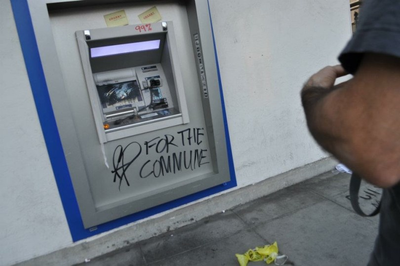 """Grafitti """"99%"""" and """"For the Commune"""" on vandalized bank ATM; 2011 Occupy"""