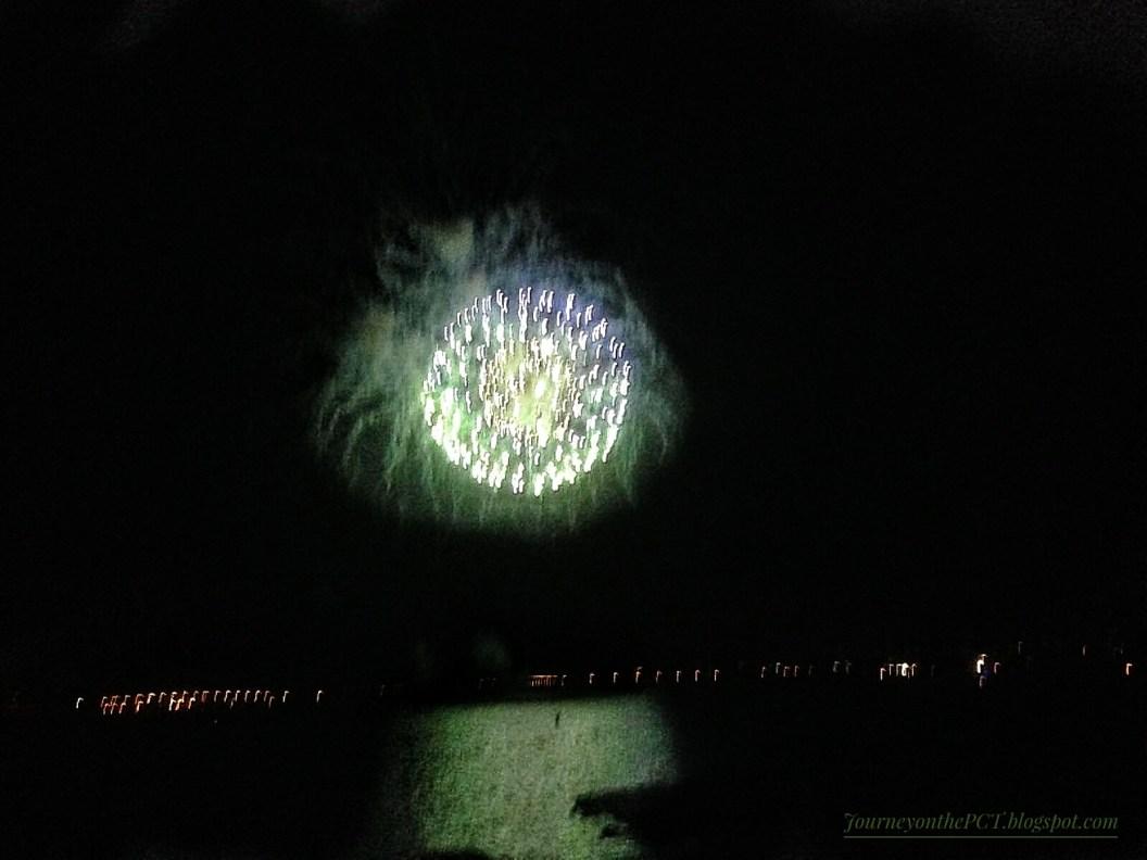 The Ocean mirrors a firework