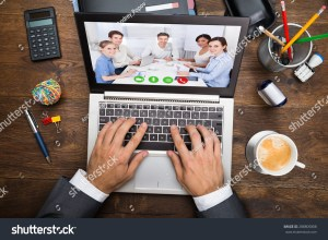 stock-photo-businessman-in-video-chatting-with-his-colleagues-on-laptop-288805808